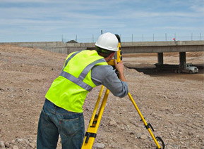 Construction Worker on Site Using Trimble Total Station
